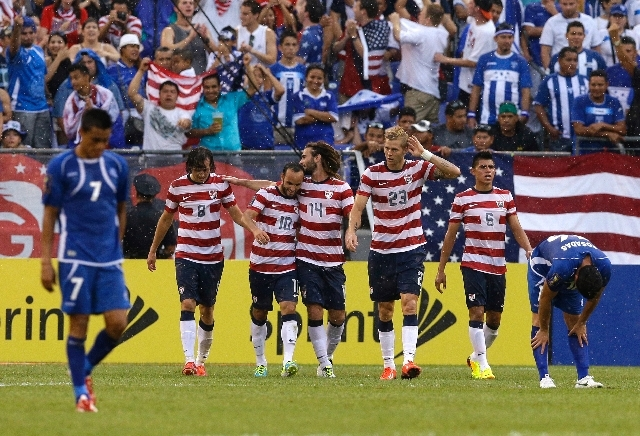 United States teammates celebrate a goal by Mix Diskerud (8) against El Salvador during the second half in the quarterfinals of the CONCACAF Gold Cup soccer tournament on Sunday in Baltimore.