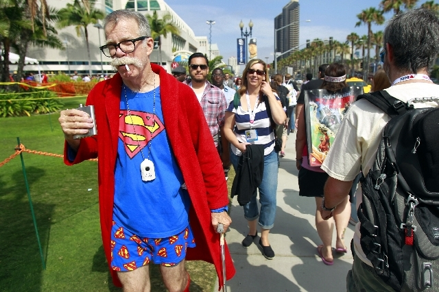 Gary McAuley, dressed as retired Superman, walks to the Comic-Con convention Friday in San Diego.
