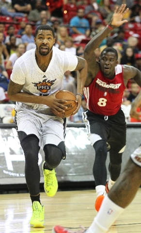 Phoenix Suns forward Marcus Morris, left, attempts to stay ahead of James Nunnally of the Miami Heat during the teams' NBA Summer League semifinal Sunday at the Thomas & Mack Center. The 6-foot-9- ...