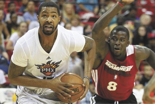 Marcus Morris, left, of the Suns eludes James Ennis of the Miami Heat during Phoenix's 91-89 victory in the NBA Summer League semifinals Sunday at the Thomas & Mack Center.