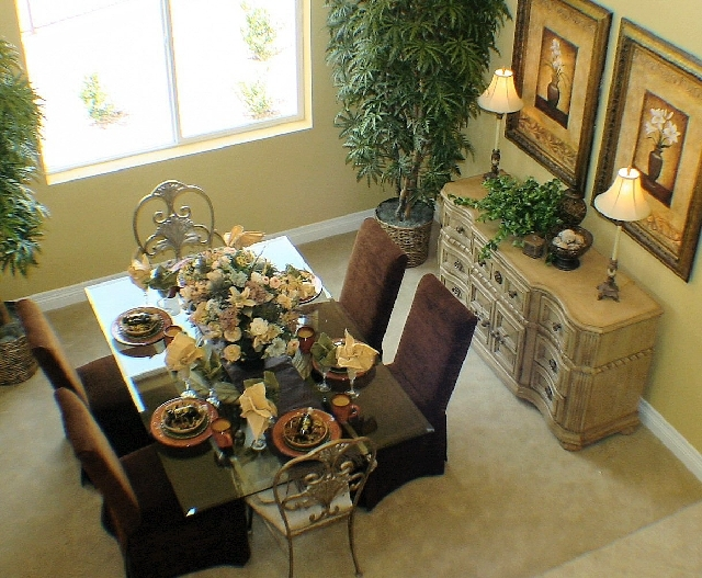 When selecting a dining table, use the room's size and shape to guide your choice.