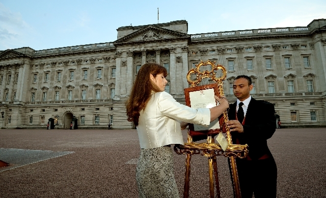 The Queen's Press Secretary Ailsa Anderson with Badar Azim, a footman, places an official document to announce the birth of a baby  boy, at 4.24pm to the William and Kate, the Duke and Duchess of  ...