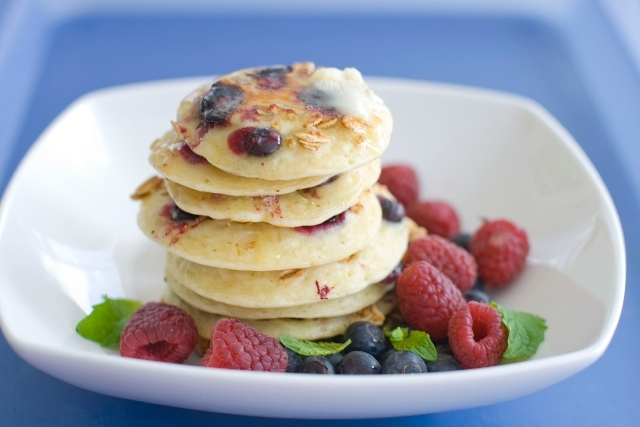 This March 2012 file photo shows a plate of pancakes with blueberries and granola mixed in the batter in Concord, N.H. A study of older men found those who regularly skipped breakfast had a 27 per ...