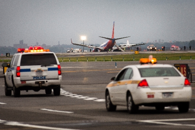 A southwest airlines plane rests on the tarmac after what officials say was a nose gear collapse during a landing at LaGuardia Airport, Monday, July 22, 2013, in New York. The Federal Aviation Adm ...