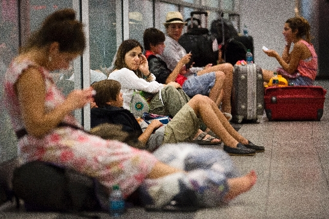 Stranded passengers wait in LaGuardia Airport as multiple flights were canceled after a Southwest Airlines 737 plane's nose gear collapsed during a landing, Monday, July 22, 2013, in New York. The ...