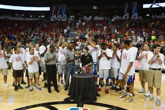 The NBA Summer League championship trophy is presented to the Golden State Warriors after they defeated the Phoenix Suns at the Thomas & Mack Center in Las Vegas on Monday.