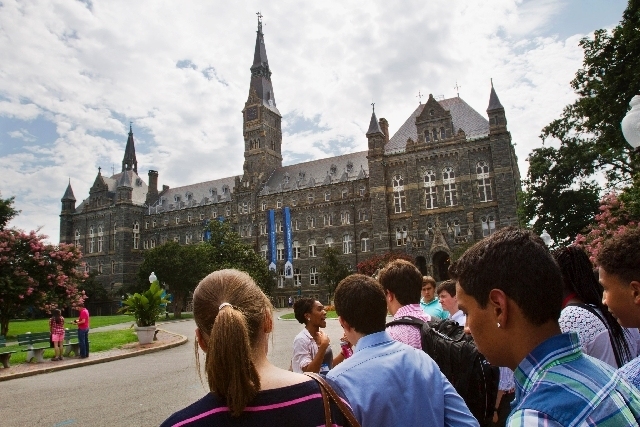 Prospective students tour Georgetown University's campus in Washington, in this July 10 photo. Grants and scholarships are taking a leading role in paying college bills, surpassing the traditional ...