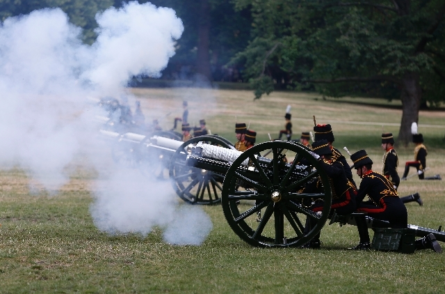 The King's Troop Royal Horse Artillery fire a 41 Royal Gun Salute in Green Park, to mark the birth of a baby boy of Prince William and Kate, Duchess of Cambridge, in London, Tuesday, July 23.