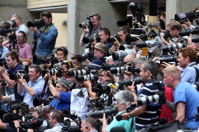 Photographers take pictures of The Duchess of Cambridge's parents Carole and Michael Middleton as they arrive at the Lindo Wing of St Mary's Hospital in London, to meet their new grandson Tuesday, ...