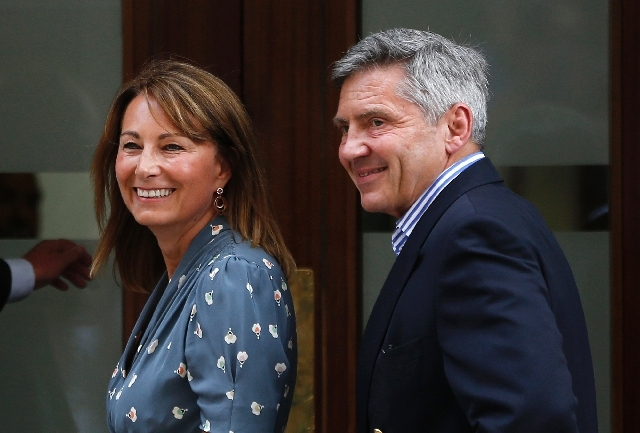 Carole and Michael Middleton, the parents of Kate, Duchess of Cambridge, smile as they arrive at St. Mary's Hospital exclusive Lindo Wing in London, Tuesday, July 23, where the Duchess gave birth  ...