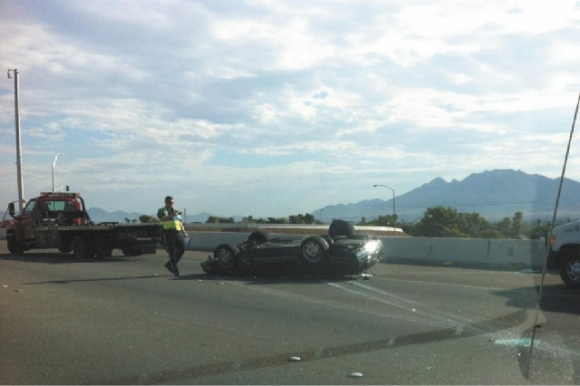 A car overturned in a single-vehicle accident Tuesday morning on U.S. Highway 95 near the Tropicana exit. The driver suffered non-life-threatening injuries.