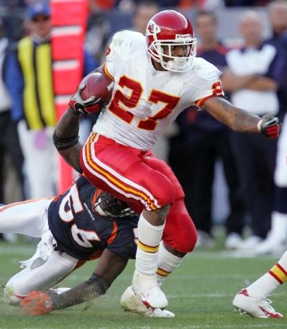 Kansas City Chiefs running back Larry Johnson (27) breaks a tackle from Denver Broncos linebacker Al Wilson (56) during the fourth quarter of a football game in Denver on Sept. 17, 2006. Johnson s ...