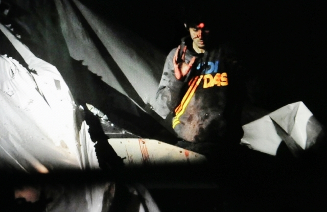 In this Friday, April 19 Massachusetts State Police file photo, 19-year-old Boston Marathon bombing suspect Dzhokhar Tsarnaev, bloody and disheveled with the red dot of a sniper's rifle laser sigh ...