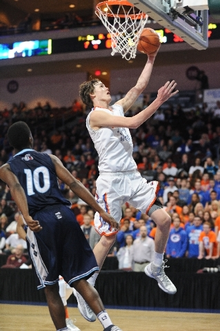 Bishop Gorman's Stephen Zimmerman lays up the ball past Centennial's Marcus Allen during the NIAA Division 1 State Boys Basketball Championship game at Orleans Arena in February.