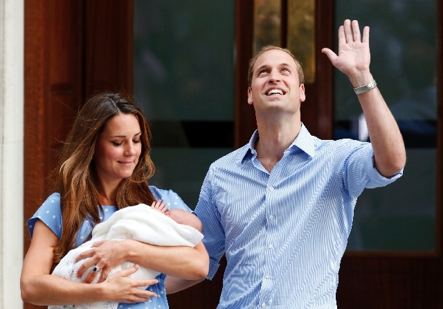 Britain's Prince William and Kate, Duchess of Cambridge hold the Prince of Cambridge, Tuesday July 23 as they pose for photographers outside St. Mary's Hospital exclusive Lindo Wing in London wher ...