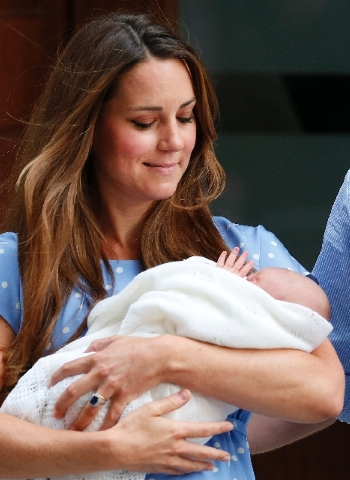 Kate, Duchess of Cambridge looks down as she holds the Prince of Cambridge, Tuesday July 23, as she poses for photographers outside St. Mary's Hospital exclusive Lindo Wing in London where the Duc ...