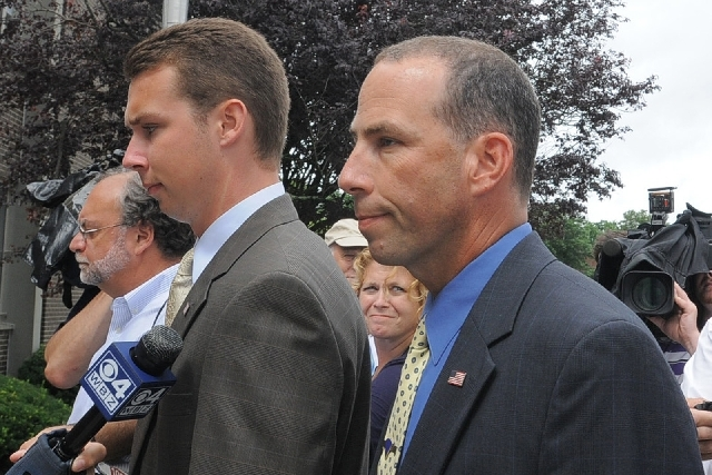 Massachusetts State Police Sgt. Sean Murphy, right, a tactical photographer, and his son Connor Patrick Murphy, arrive at State Police Headquarters for his hearing to determine his duty status aft ...