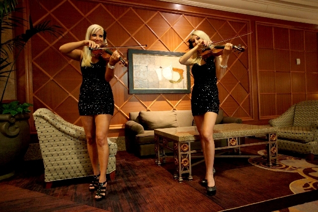 Ashley Korak, left, and Adrianna Thurber, both of Las Vegas, provide entertainment during a break Tuesday at the Meeting Professionals International convention at Mandalay Bay Convention Center in ...