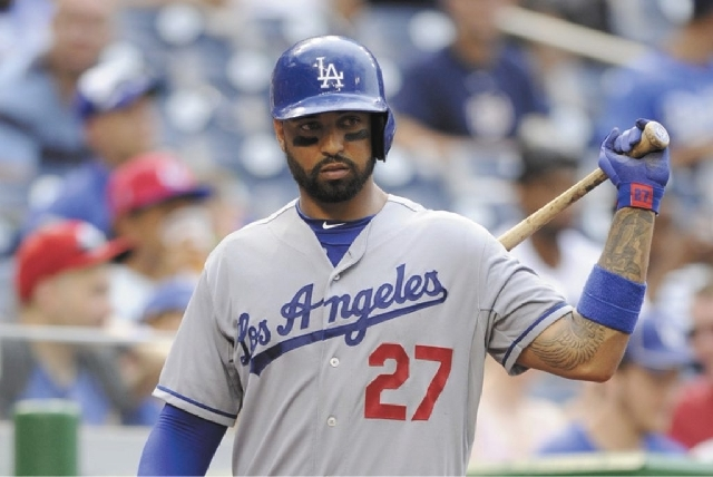 Los Angeles Dodgers' Matt Kemp waits to bat against the Washington Nationals on Sunday.