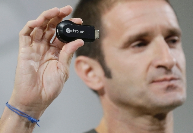 Google's new Chromecast device is shown by Mario Queiroz, vice president for product management, on Wednesday in San Francisco.