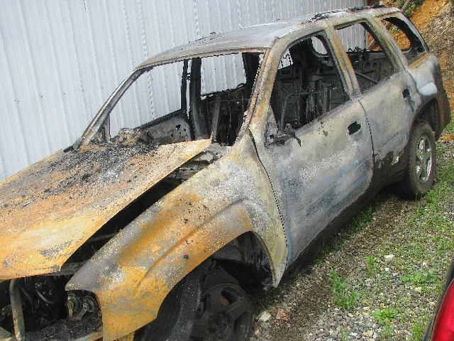 A burned out vehicle is shown near Oak Ridge, Tenn. Tennessee Titans linebacker Jonathan Willard says he helped rescue a family from a burning vehicle on his way to NFL football training camp on T ...