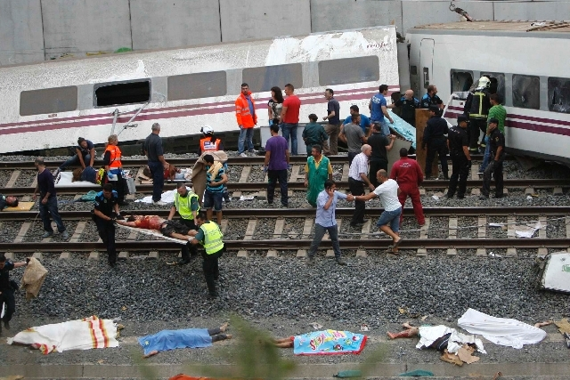 Emergency personnel respond to the scene of a train derailment in Santiago de Compostela, Spain, Wednesday, July 24.