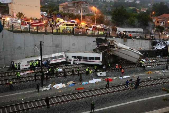 Emergency personnel respond to the scene of a train derailment in Santiago de Compostela, Spain, on Wednesday, July 24.