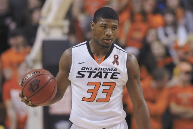 Oklahoma State guard Marcus Smart lost his 33-year-old brother, Todd, to leukemia when he was just 9.