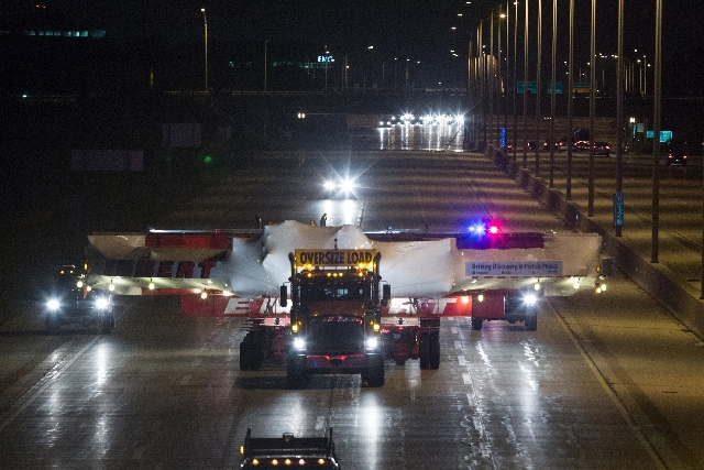 The electromagnet moves down Interstate 88 in Naperville, Ill., Friday, July 26 on its way to Fermilab. The electromagnet is 50 feet wide, weighs more than 15 tons and has taken a month to transpo ...