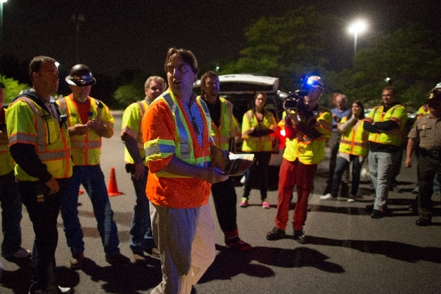 Chris Polly, center, project director for Fermilab, speaks during a safety briefing in Glen Ellyn, Ill., Thursday, July 25 before the final move of the electromagnet. The electromagnet is 50 feet  ...