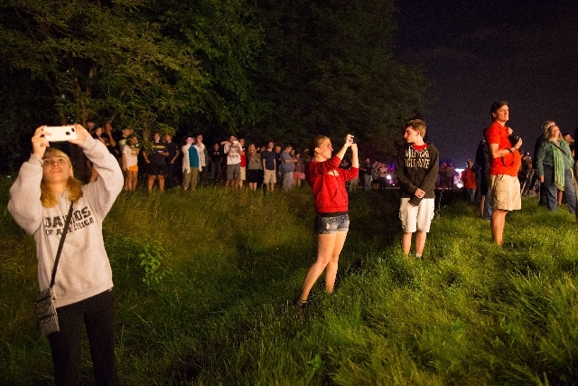 Onlookers watch and take photos as the electromagnet passes by on Butterfield Road in Glen Ellyn, Ill., Thursday, July 25 enroute to its new home outside Chicago on Friday.  The electromagnet is 5 ...