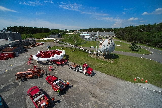 In this undated photo provided by Brookhaven National Laboratory, the 50-foot-wide electromagnet Muon g-2 ring is loaded onto a specially adapted truck and ready to be transported across the Brook ...