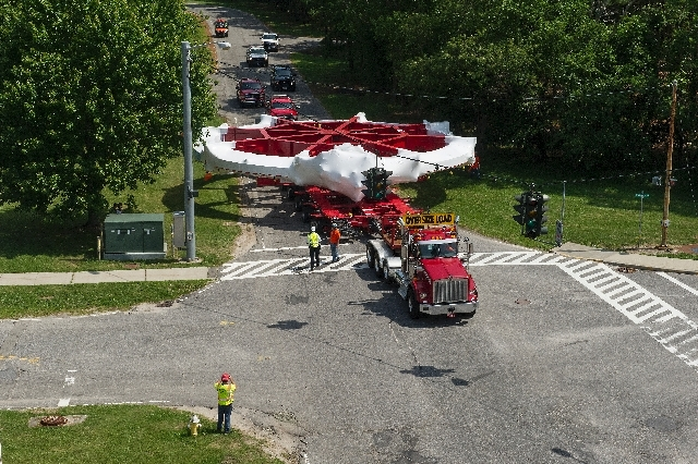In this June 22 photo provided by Brookhaven National Laboratory, a 50-foot electromagnet Muon g-2 ring is transported as it crosses an intersection on the Brookhaven National Laboratory site on N ...