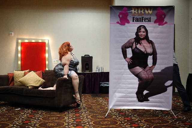 Jezebel Jolie sits for a photographer during the BBW Fanfest on Friday at the Tuscany. The event celebrates big, beautiful women, with an adult-industry emphasis. An organizer hopes to eventually  ...