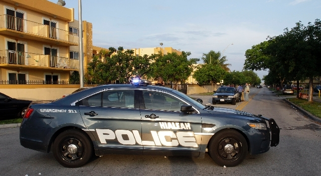 City of Hialeah, Fla., police block off the area of an apartment building at the scene of a fatal shooting in Hialeah, Fla., Saturday.
