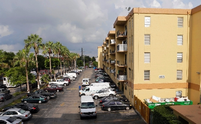 The apartment building where a fatal shooting took place is shown in Hialeah, Fla., Saturday.