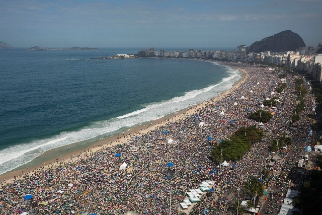 Crowds line the Copacabana beachfront as they attend the World Youth Day's concluding Mass celebrated by Pope Francis, in Rio de Janeiro, Brazil, Sunday.