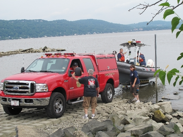 Members of the fire and rescue squad in Piermont, N.Y., launch a boat on Sunday to help search for Mark Lennon, 30, who was missing after a boating accident in the Hudson River. A body believed to ...