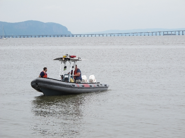 Members of the fire and rescue squad in Piermont, N.Y., begin searching on Sunday for Mark Lennon, 30, who was missing after a boating accident in the Hudson River on Friday night. A body believed ...