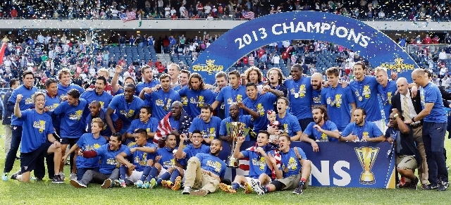 United States players celebrate with the trophy after defeating Panama 1-0 in the CONCACAF Gold Cup final soccer match at Soldier Field, Sunday, July 28, 2013, in Chicago