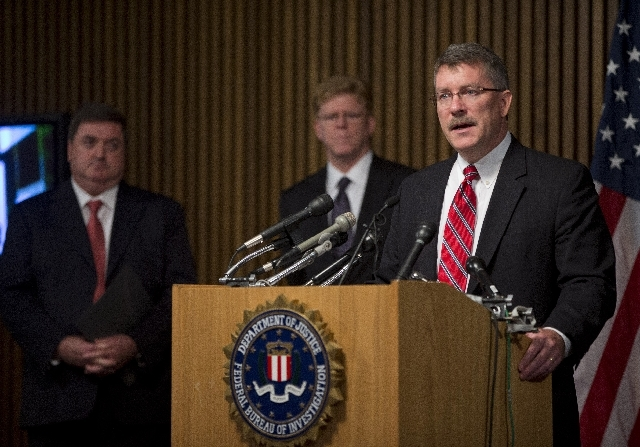 """Ron Hosko, assistant director of the FBI's Criminal Investigative Division, right, speaks during a news conference at FBI headquarters in Washingotn, Monday, July 29,  about """"Operation Cross Count ..."""