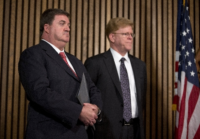 John Ryan, CEO of National Center for Missing and Exploited Children, left, and Drew Oosterbaan, chief of the DOJ Child Exploitation and Obscenity Section look on during a news conference at FBI h ...