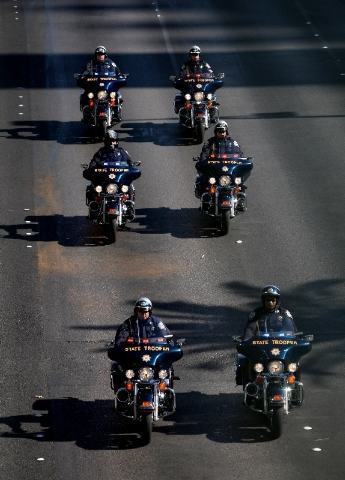Law enforcement officers clear the way for a funeral procession down the Strip Monday for Las Vegas police officer David VanBuskirk, who was killed July 21 during the rescue of a hiker stranded on ...