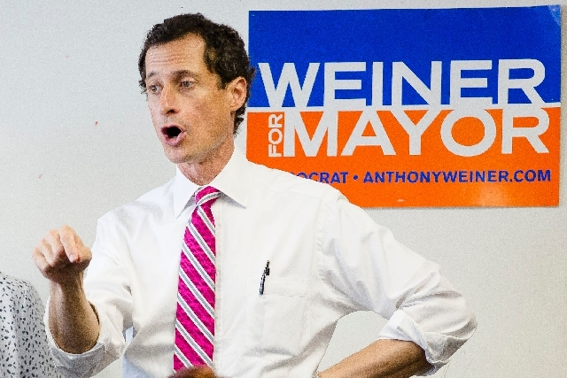 New York City mayoral candidate Anthony Weiner speaks to voters Monday during a campaign stop in the Queens borough of New York. A new poll by Quinnipiac University, conducted from Wednesday to Su ...