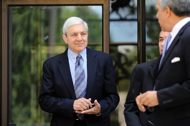 Former Penn State President Graham Spanier leaves the Dauphin County Courthouse Monday in Harrisburg, Penn. Spanier faces charges in the child sex abuse scandal involving former assitant football  ...