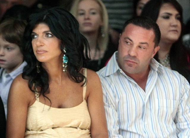 """This Sept. 13, 2009 file photo originally released by Oral-B Pulsonic shows """"Real Housewives of New Jersey"""" stars, Teresa Giudice, left, and her husband Joe Giudice at the Caravan Fashion Show spo ..."""