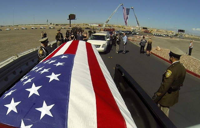 In a video frame grab provided by Las Vegas Metro PD, the casket of Officer David VanBuskirk is seen during the his  funeral procession on Monday. VanBuskirk  was killed on July 22 during the heli ...