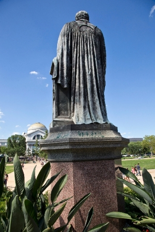 Green paint is seen on the pedestal of the statue of Joseph Henry, outside the headquarters of the Smithsonian Institution on the National Mall in Washington, Monday.