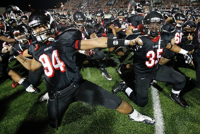 "In this Dec. 3, 2010 file photo, Trinity High School football players  Polo Manukainiu (94) and Paul Tuipulotu (35) perform a ""Haka"" with the team before a game against Coppell in Southlake, Texas ..."