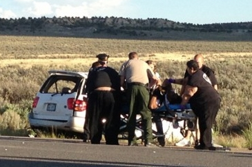 This video frame grab released by KRQE.com shows police and medical personal attending to car wreck that happened Monday evening on U.S. 550 near Cuba, about 85 miles north of Albuquerque. Texas A ...